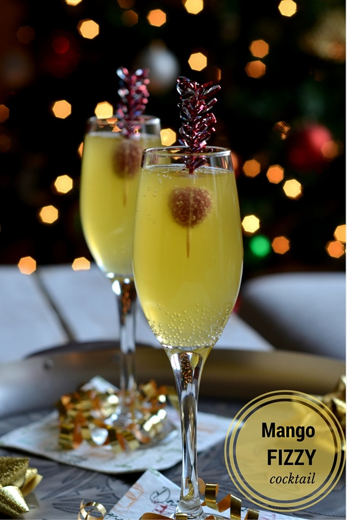 Mango Fizzy Cocktail - An easy tropical cocktail to serve in champagne flutes for New Years party or other entertaining