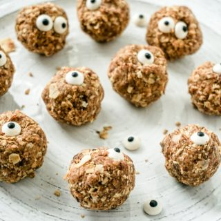 Oatmeal Energy Balls with Candy Eyes, all placed spread out on a white plate