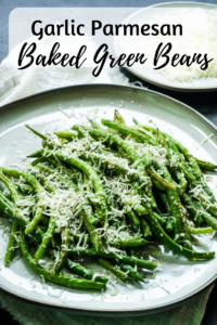 Side shot of green beans piled on a plate with grated parmesan on top and text on the image