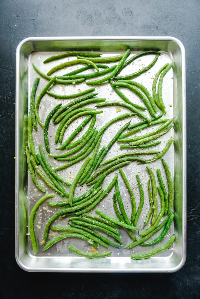 Green beans in a sheet pan ready to go in the oven