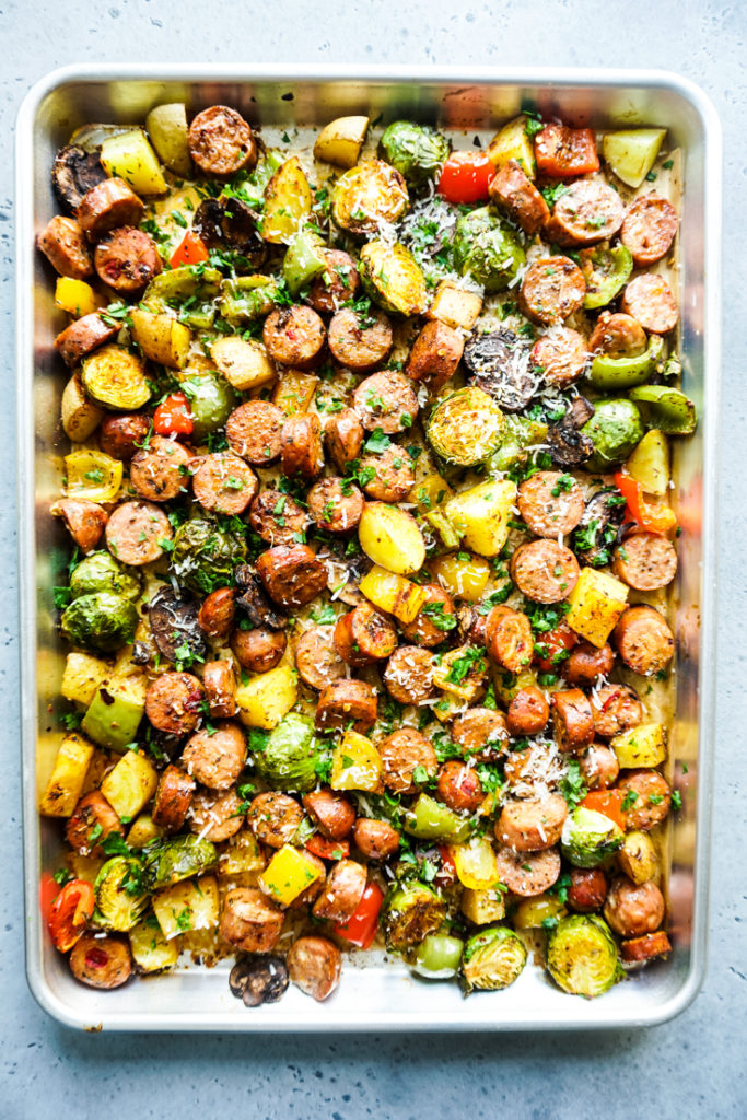 Cooked sausage and vegetables in a sheet pan
