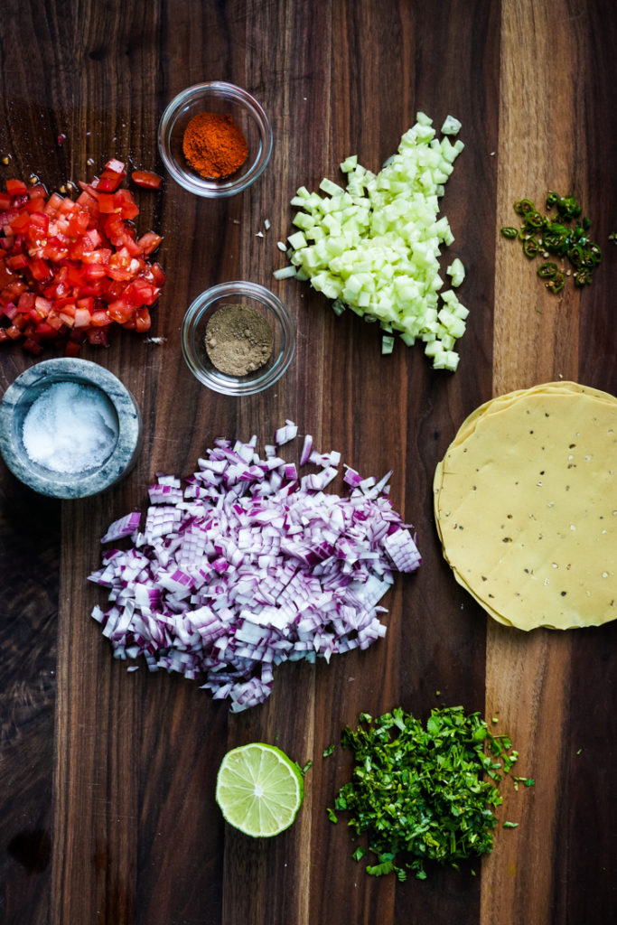 Ingredients for Masala papad placed on a wood board