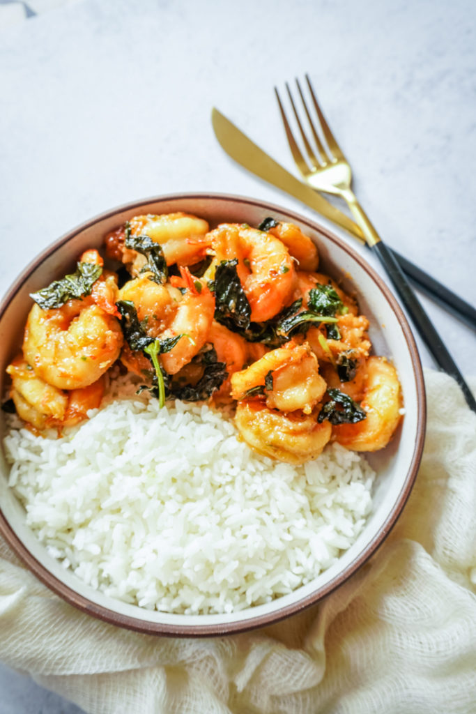 Top shot of Shrimp and basil with White rice in a bowl