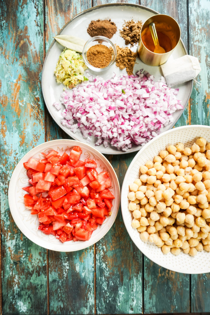 Ingredients for chana masala laid out