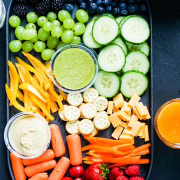 Top shot of a snack platter with rainbow colored snacks in it