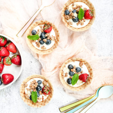 Waffle bowls with yogurt, granola and berries
