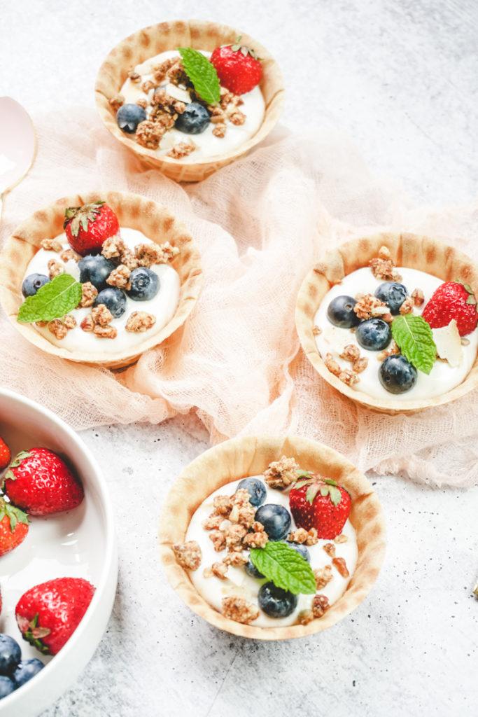 Waffle bowls with yogurt, granola and berries