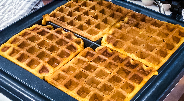 Cooked waffles in waffle iron