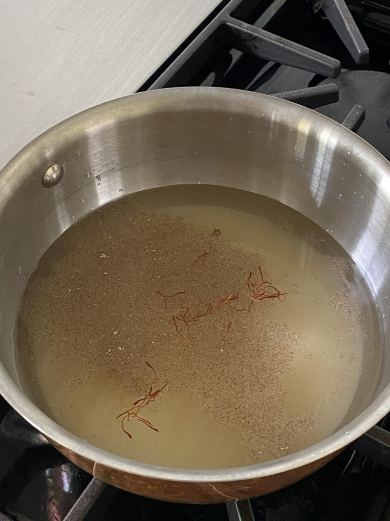ground cardamom and saffron added to the sugar water