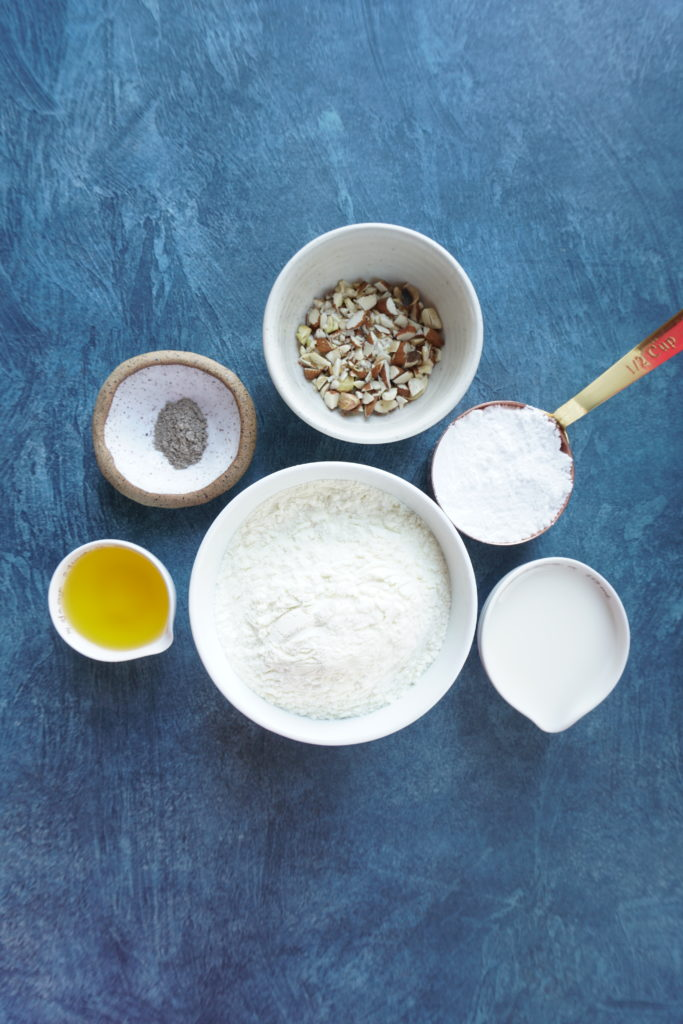 Ingredients set out for the burfi in individual bowls