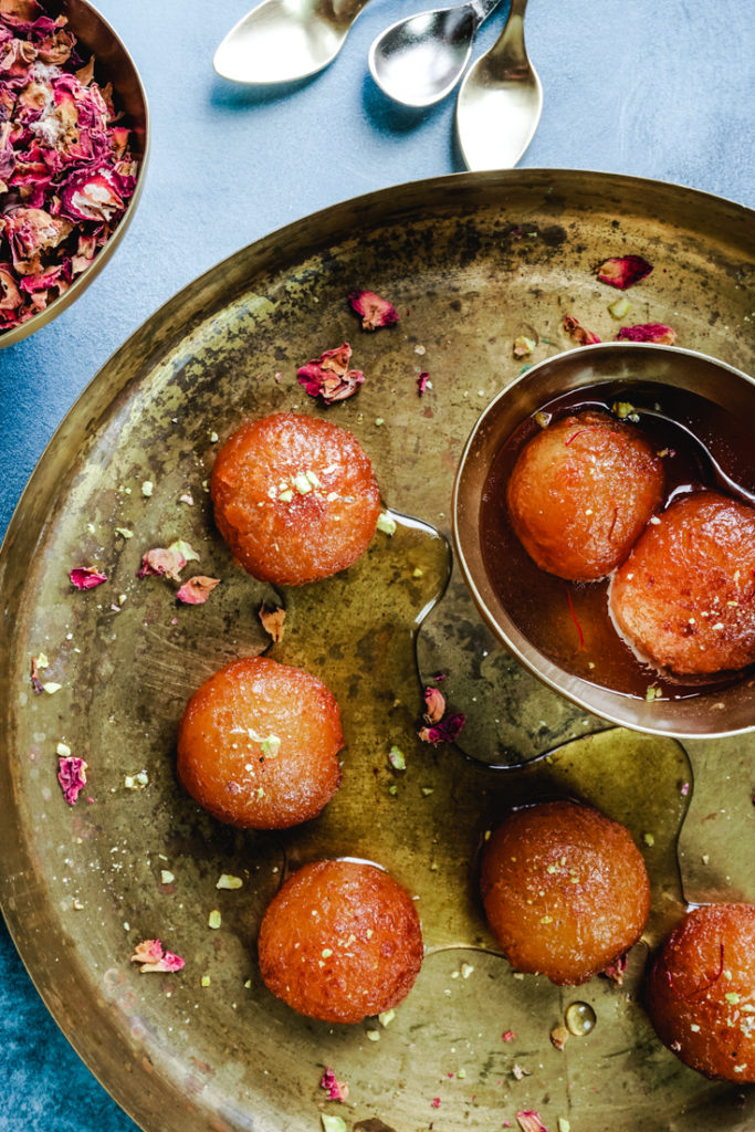platter with gulab jamun and a bowl with gulab jamun