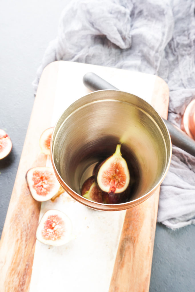 figs inside a copper cocktail shaker