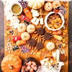 Assortment of things on a Hallween themed snack board with text on image
