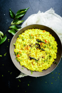 top shot of grey bowl with rasam rice in it