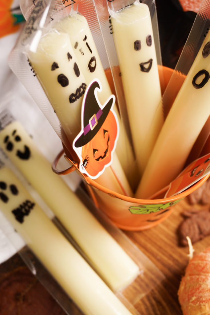 String cheese with faces drawn on the wrappers