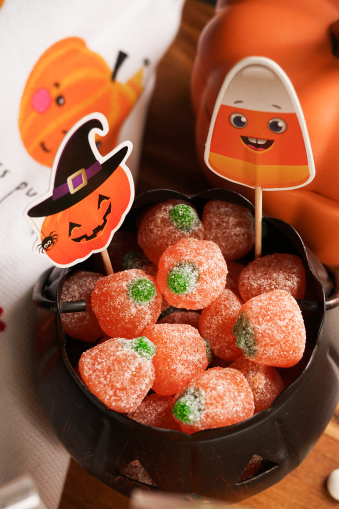 a bowl of pumpkin sour candies