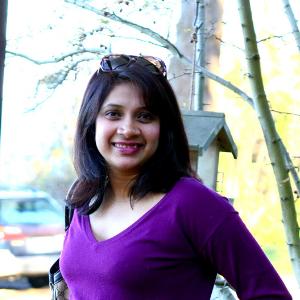 manju in a purple sweater