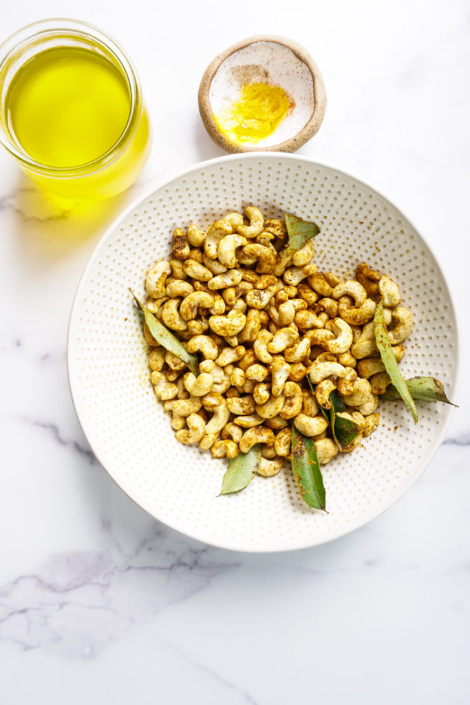 Cashew tossed with spices in a bowl