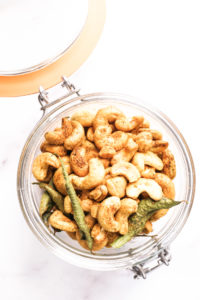 Roasted cashews in a glass jar