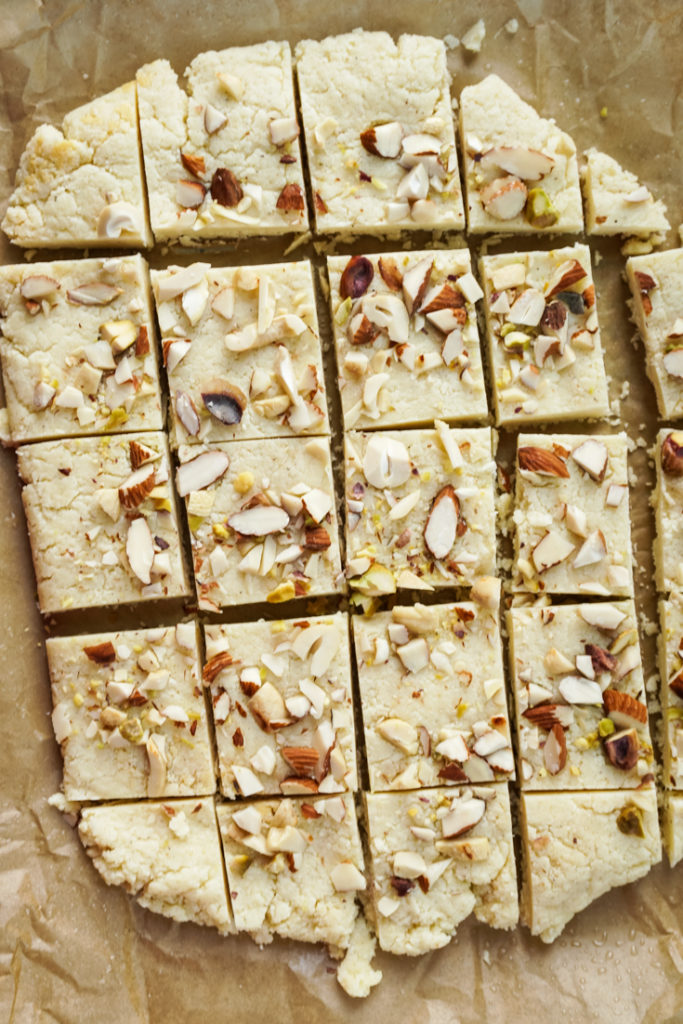 burfi on parchment paper cut into squares