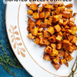 Roasted Sweet Potatoes in a platter with text overlay on image