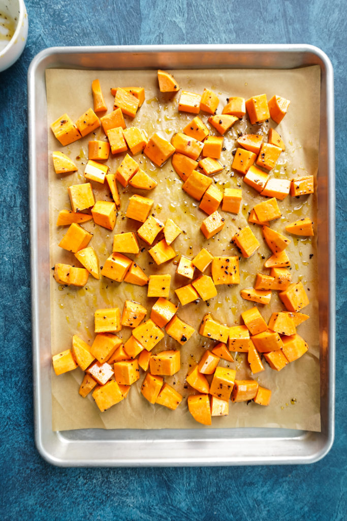 sweet potatoes in a baking tray to be roasted