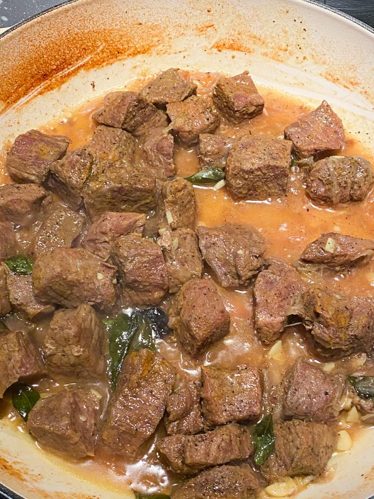 beef fry cooking in pot
