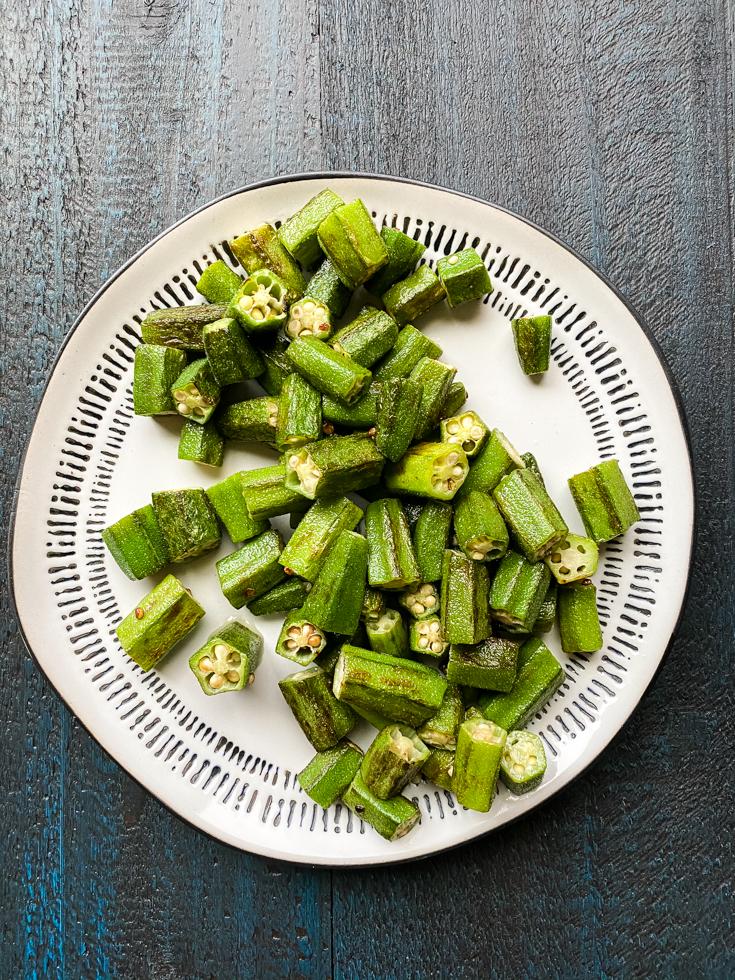 sauteed okra set on a plate