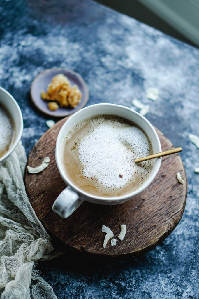 coconut cardamom latte in a white cup
