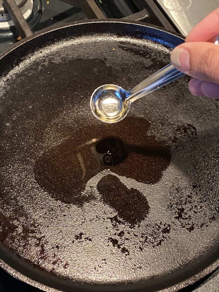 oil being poured on a hot griddle