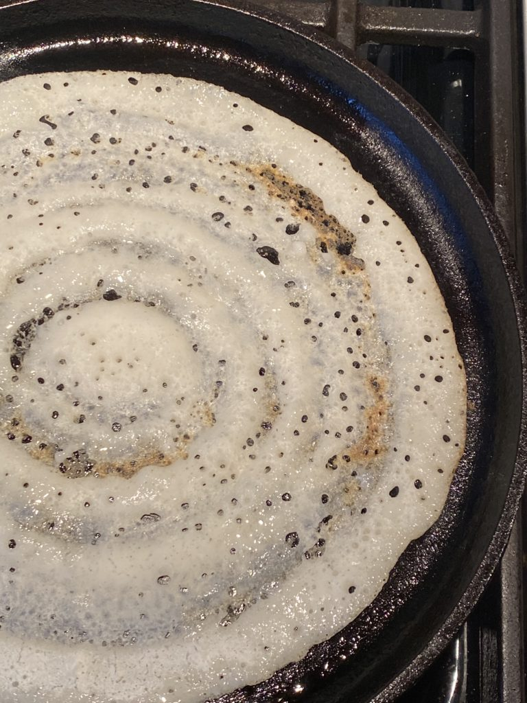crispy dosa in the griddle