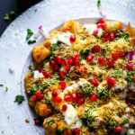 tater tots chaat on a white platter