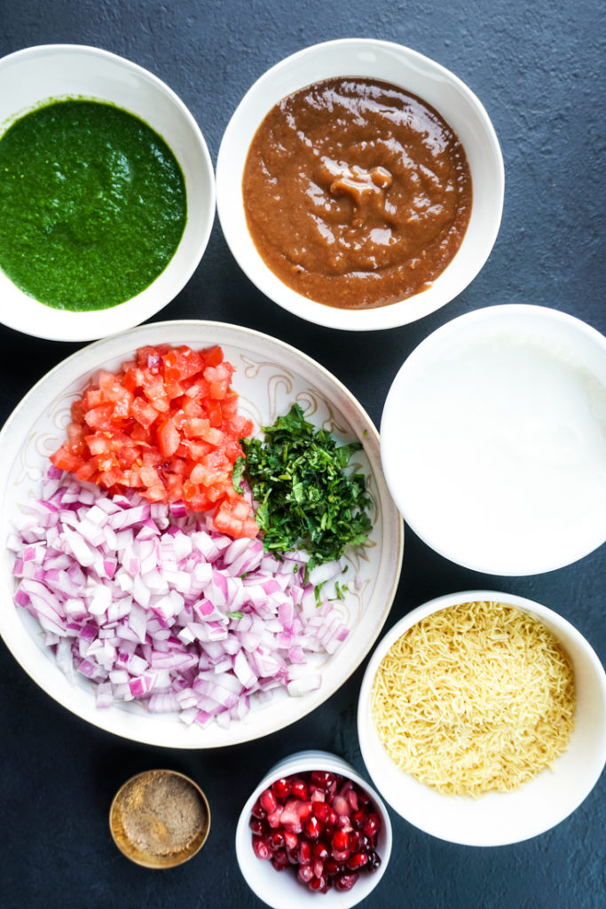 ingredients for tater tots chaat set out in bowls