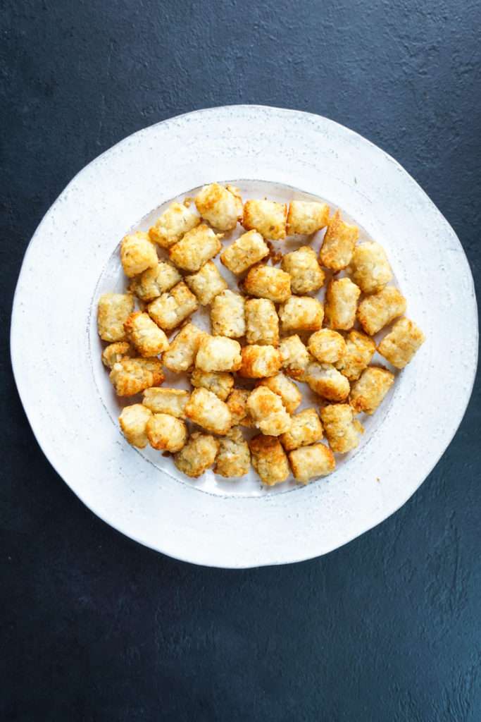 tater tots on a white platter