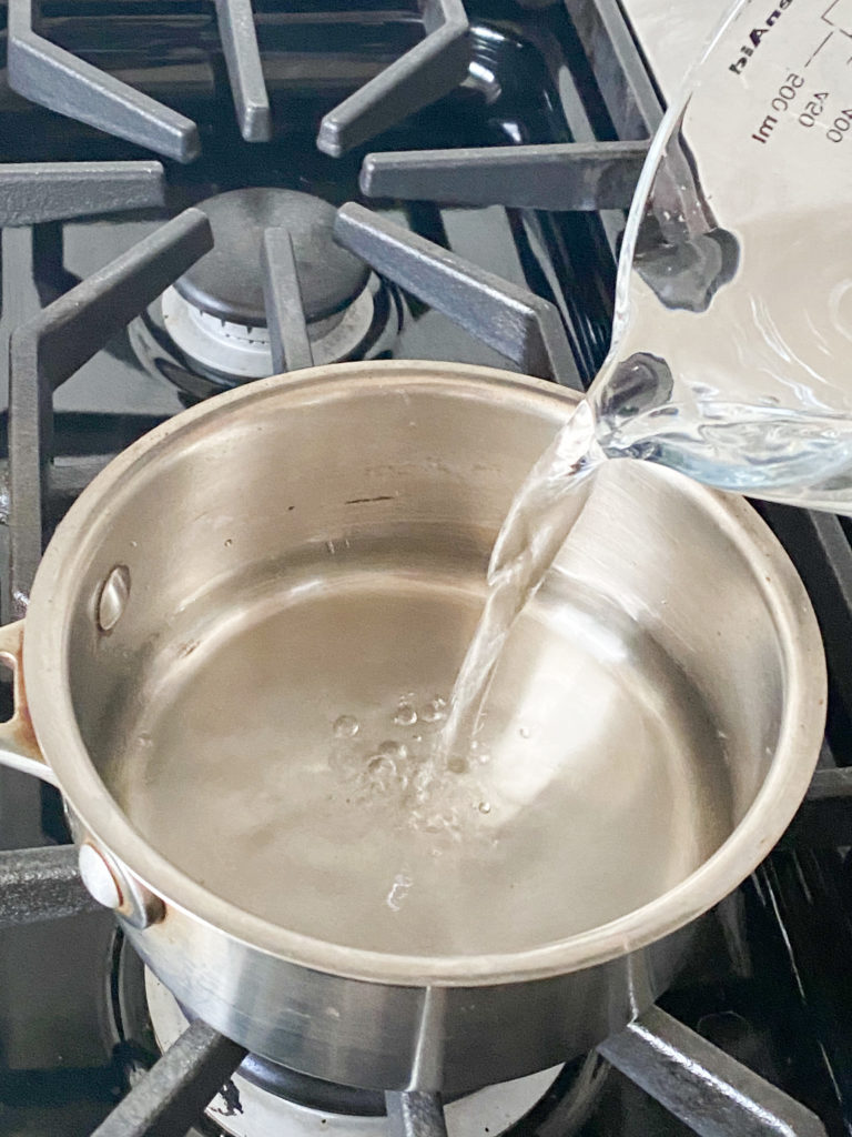 water being added to a sauce pan