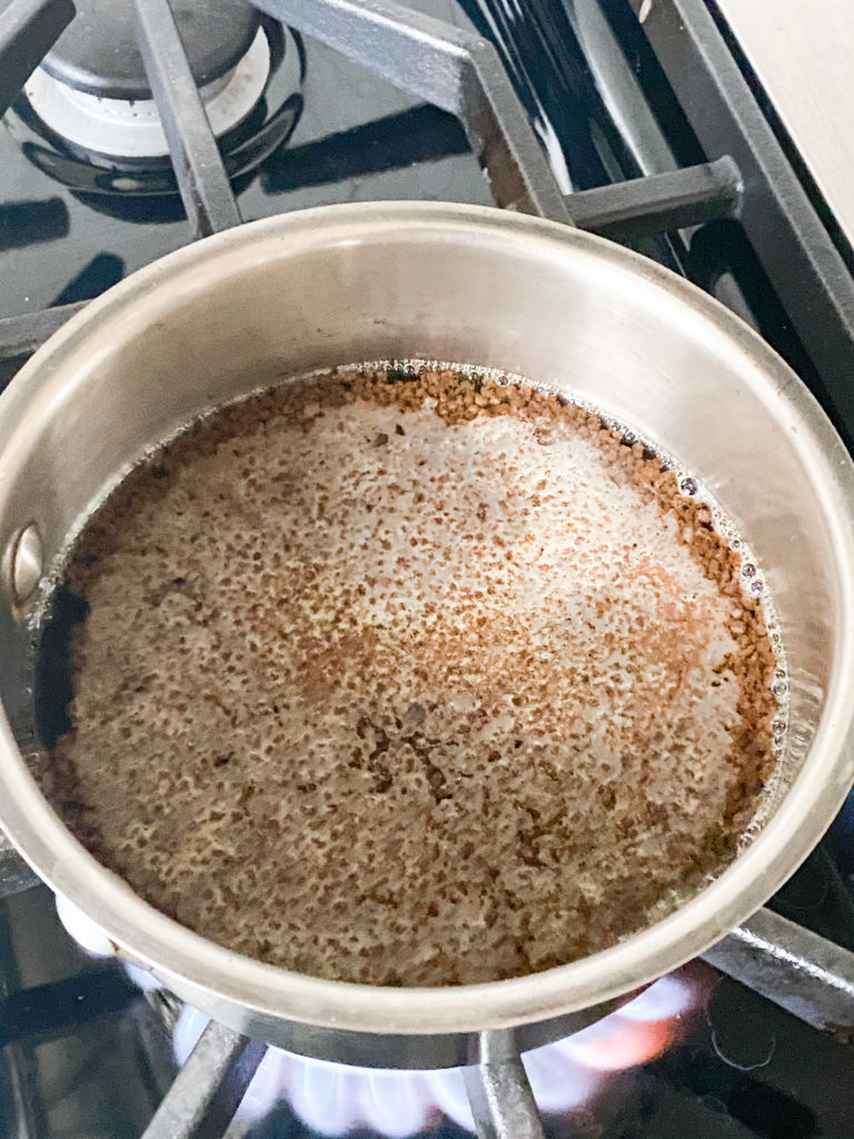 tea leaves and water in a saucepan