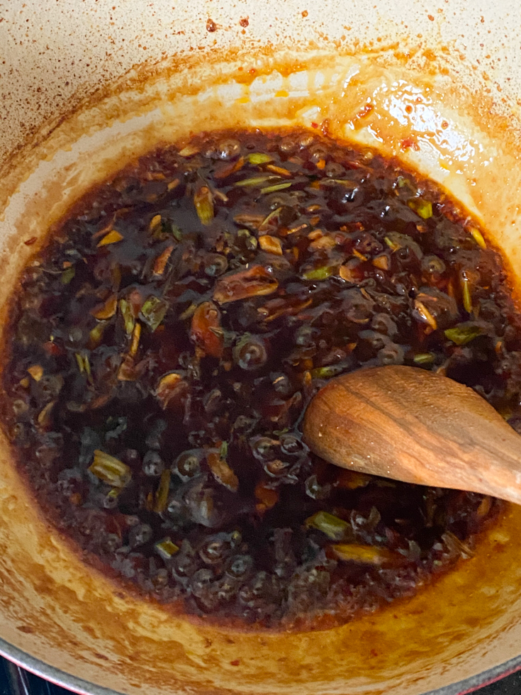 sauce being stirred in a pan