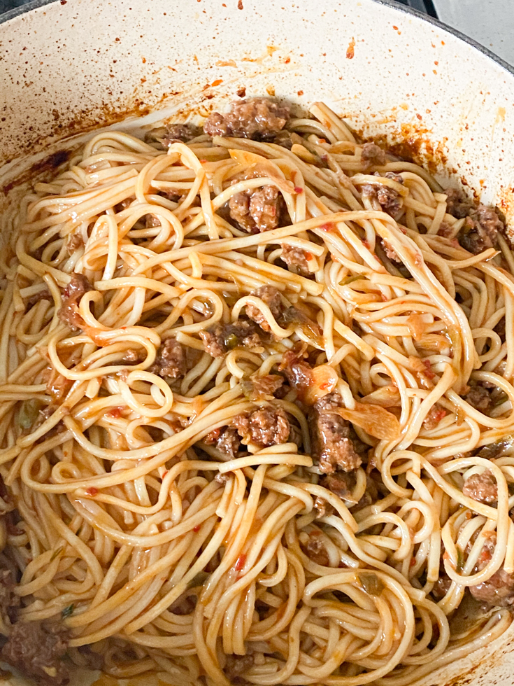 noodles mixed in with the pork in sauce