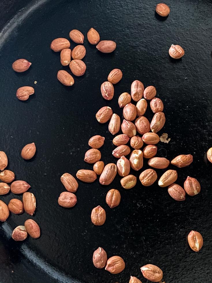 raw peanuts in skillet