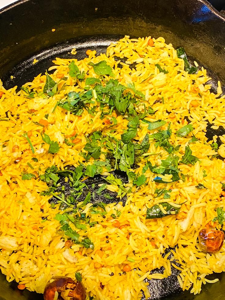 cilantro over lemon rice in a skillet