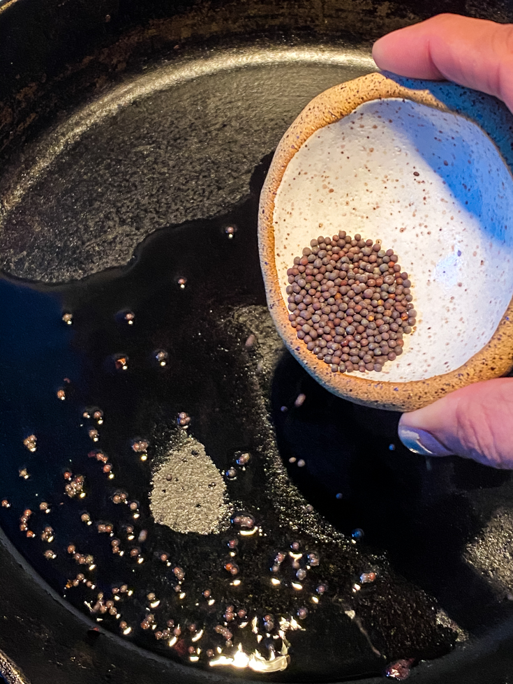 mustard seeds added to skillet