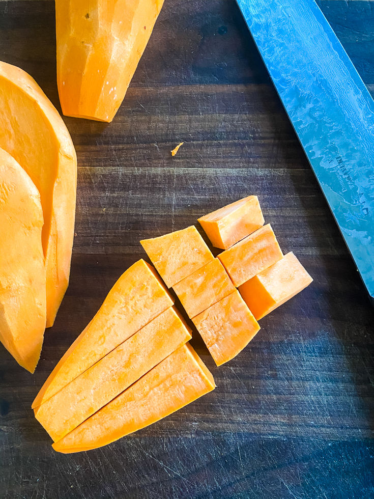 cut up sweet potatoes on chopping board