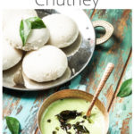 a copper bowl of cilantro coconut chutney with a plate of idlis on the side and text on image